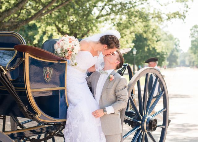Bride & Groom share kiss as she exits carriage