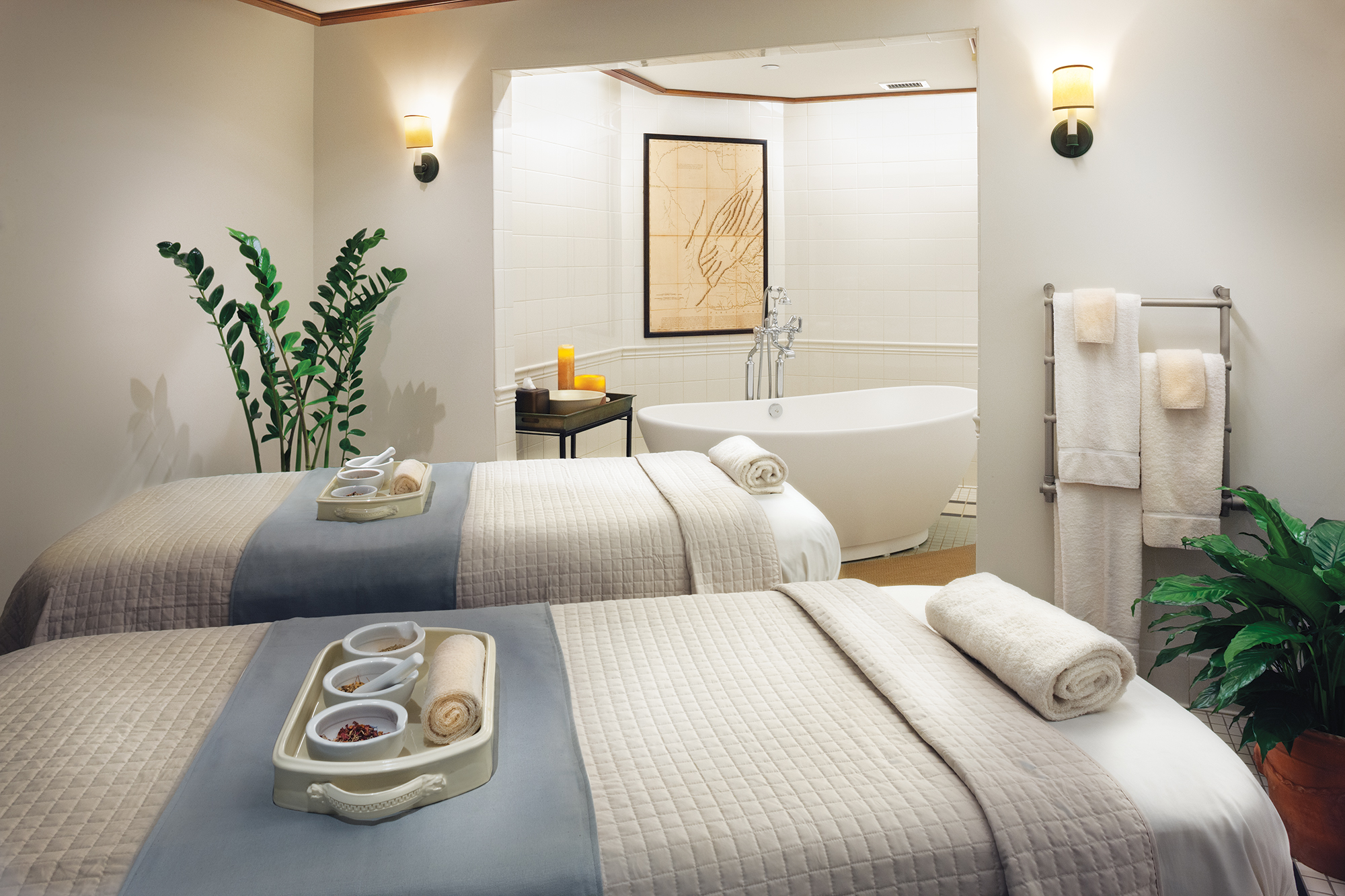 two massage tables inside spa
