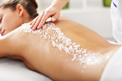 Beautiful woman having exfoliation treatment in spa