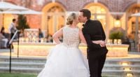 Bride and groom kiss in outdoor setting at Colonial Williamsburg