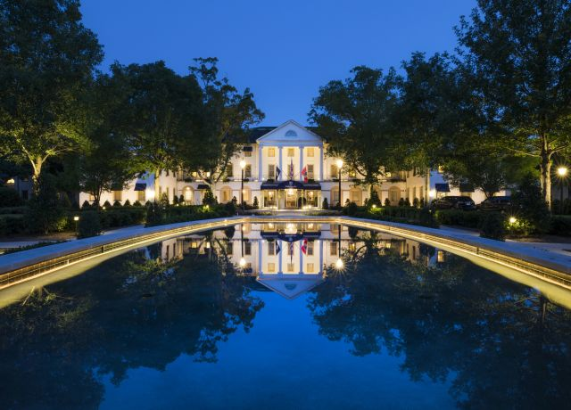 Williamsburg Inn exterior at night featuring pool