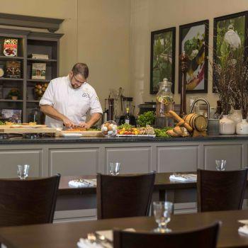 Chef Travis prepares food in Taste Studio