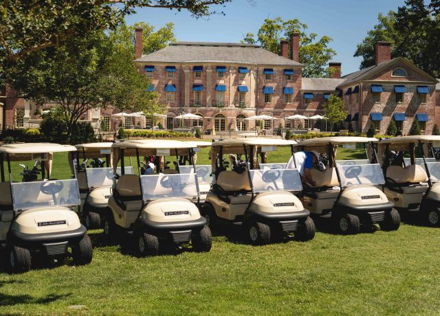 Golf carts lined up in front of Colonial Williamsburg Resort
