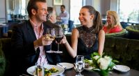 Couple toasting with wine glasses at a restaurant