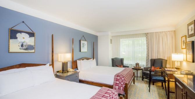 Guest suite featuring two beds at the Williamsburg Lodge