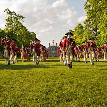 Red coat soliders marching in lines at Colonial Williamsburg