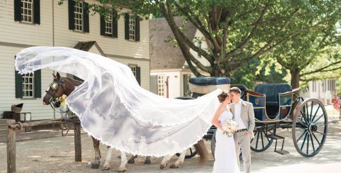 Bride & Groom in front of horse drawn carriage