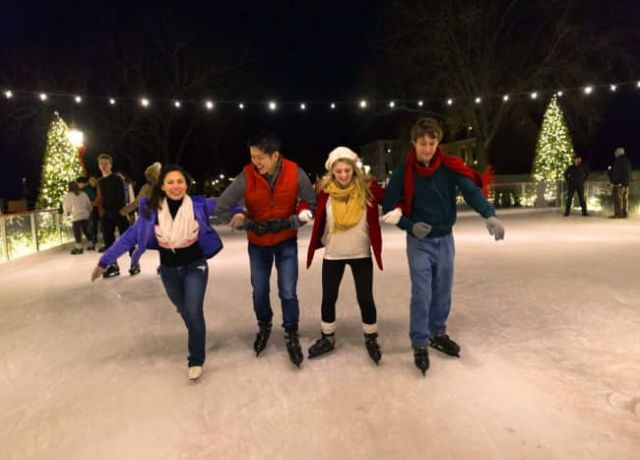 Group of 4 ice skating at night