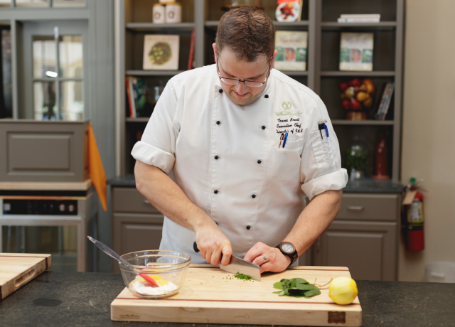 Chef Travis preparing a meal in the Taste Studio