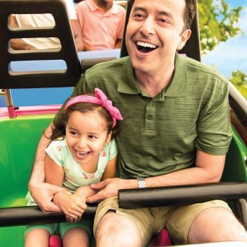 Father and Daughter enjoying roller coaster ride
