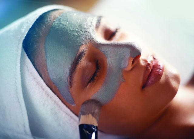 Woman receiving facial treatment