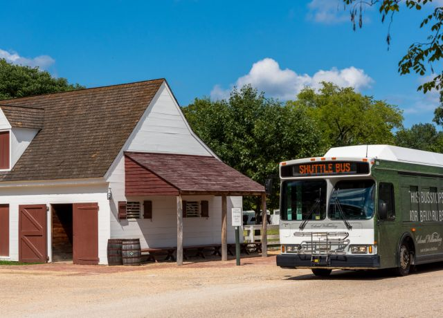 Shuttle Bus and Colonial House in Colonial Williamsburg, VA