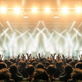 Rock concert venue with large audience and stage lights