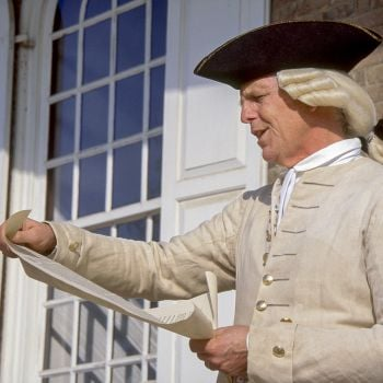 Man in Colonial dress reading decree
